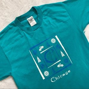 v t g | teal colored Chicago souvenir T-shirt